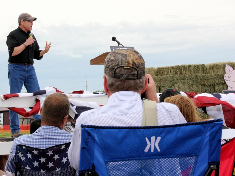 Rick Perry delivers a speech to voters in Iowa at a 'Roast and Ride' event.