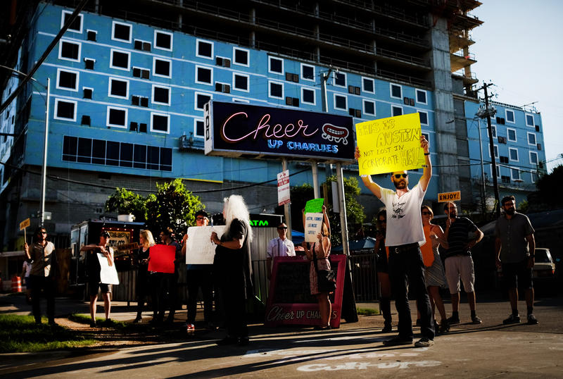 Protesters gathered to speak out against a Hyatt development near Cheer Up Charlies.