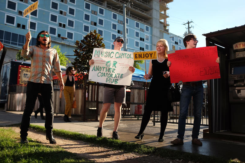The crowd at an event protesting the Hyatt hotel development adjacent to Cheer Up Charlies.