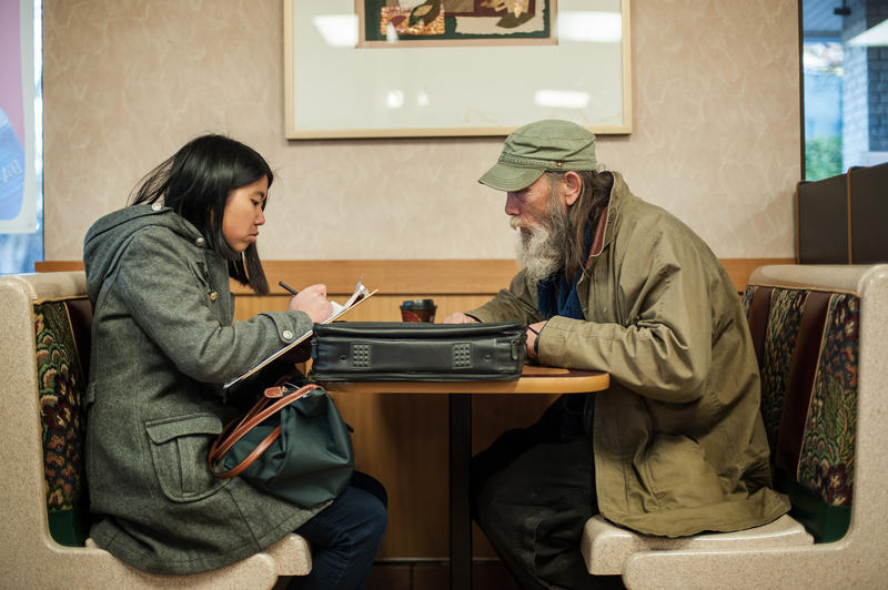Volunteer Judy Chen interviews Jerry Howell during ECHO's annual homlessness count last year.