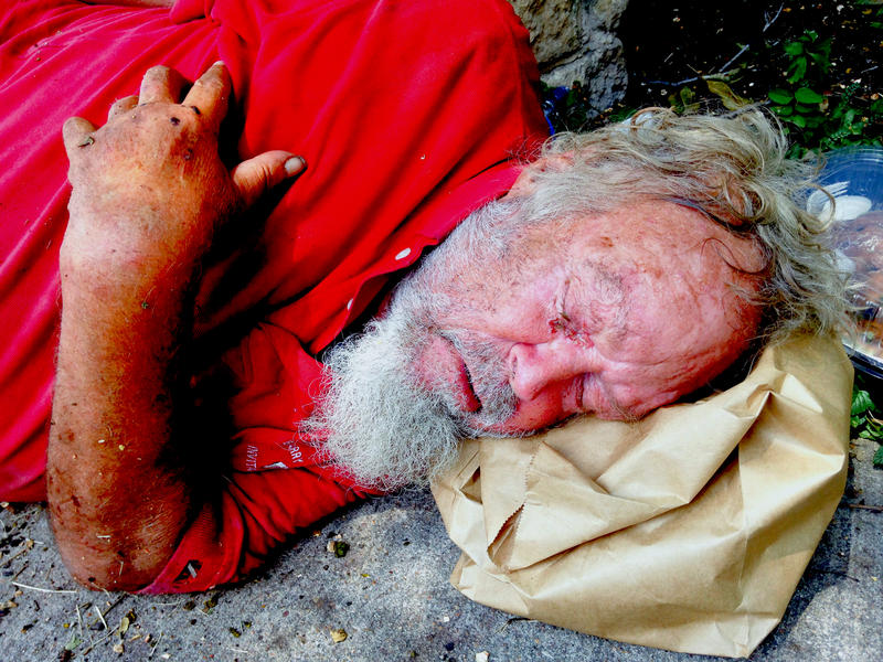 """Jackson Long is homeless and says he has a seizure disorder. He often sleeps on the ground, which puts him at risk of violating the city's """"no sit/no lie"""" ordinance."""