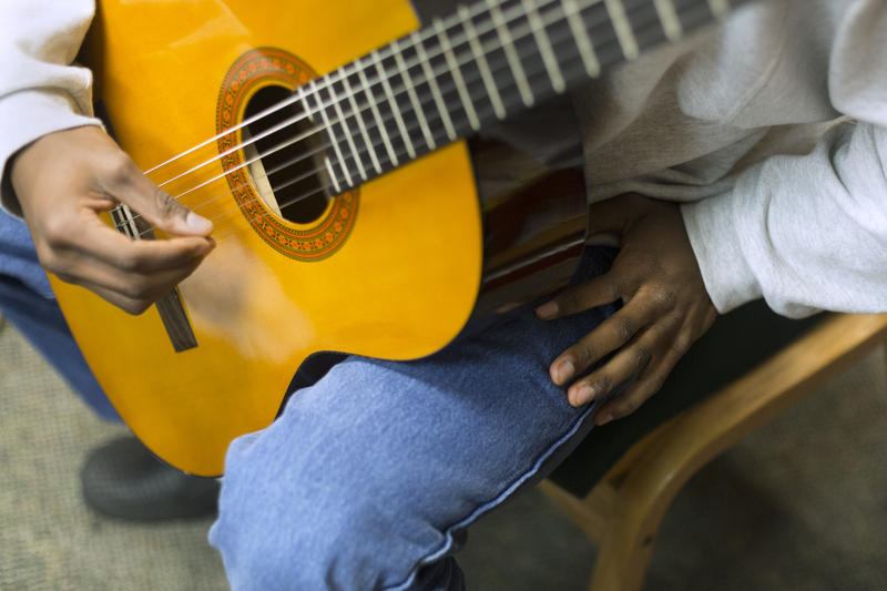 Demetrius Hardison practices classical guitar at Gardner Betts Juvenile Detention Center. 'I feel wonderful when I play guitar and write music,' he says.