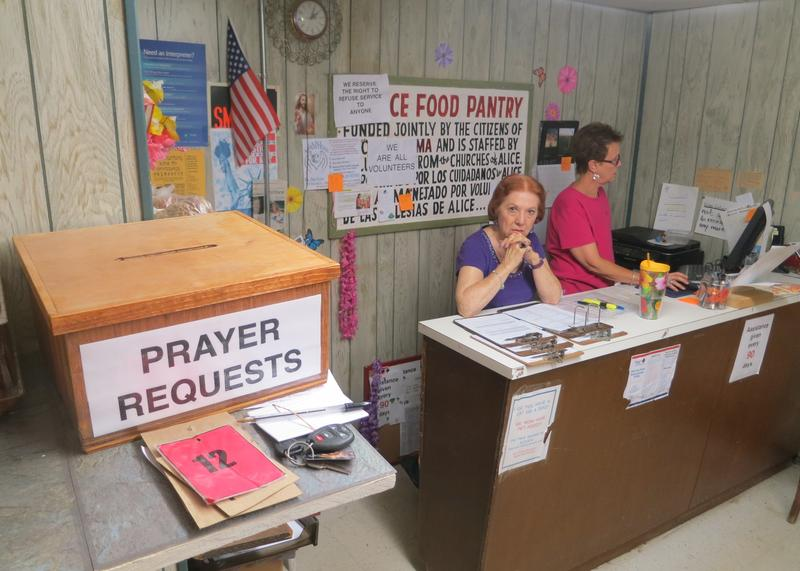 A box at the Alice Food Pantry accepts prayer requests. Many people in Alice have lost jobs since the price of oil dropped.