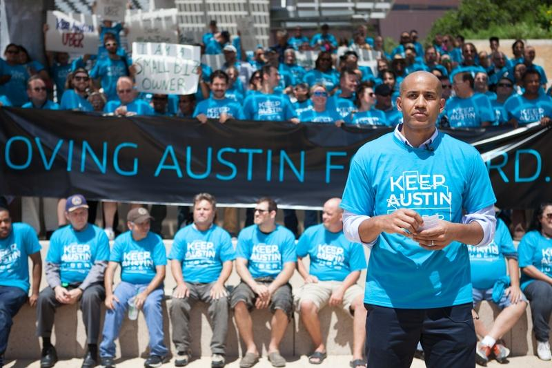 Uber's Austin General Manager, Marco McCottry, leads a march and rally against the proposal set by the Austin Transportation Department.