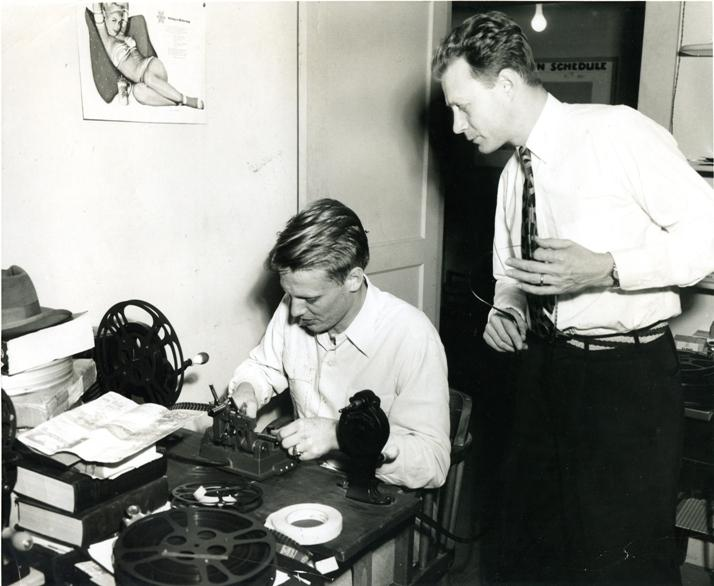 An undated photo of KUT founder Robert Schenkkan supervising a tape-cutting session.
