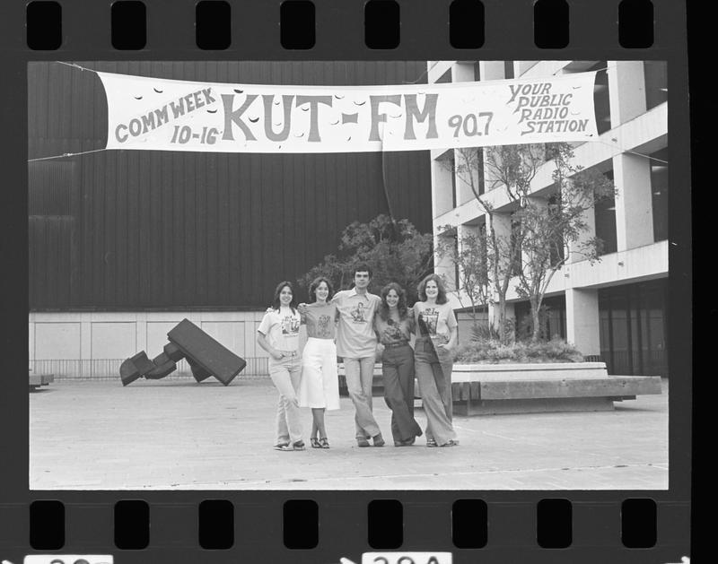 Members of the KUT family outside the UT Communications building.