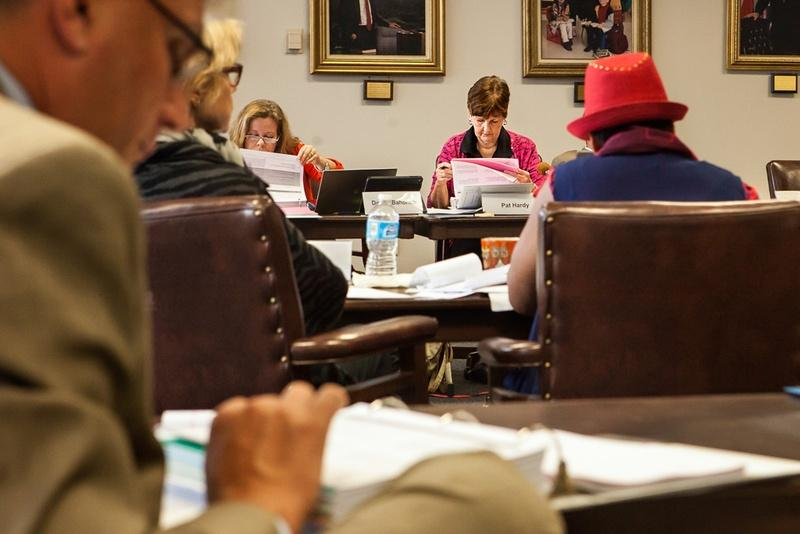 State Board of Education members work their way through proposed revisions to social studies textbooks at a meeting with publishers in Austin on Monday, October 20, 2014.