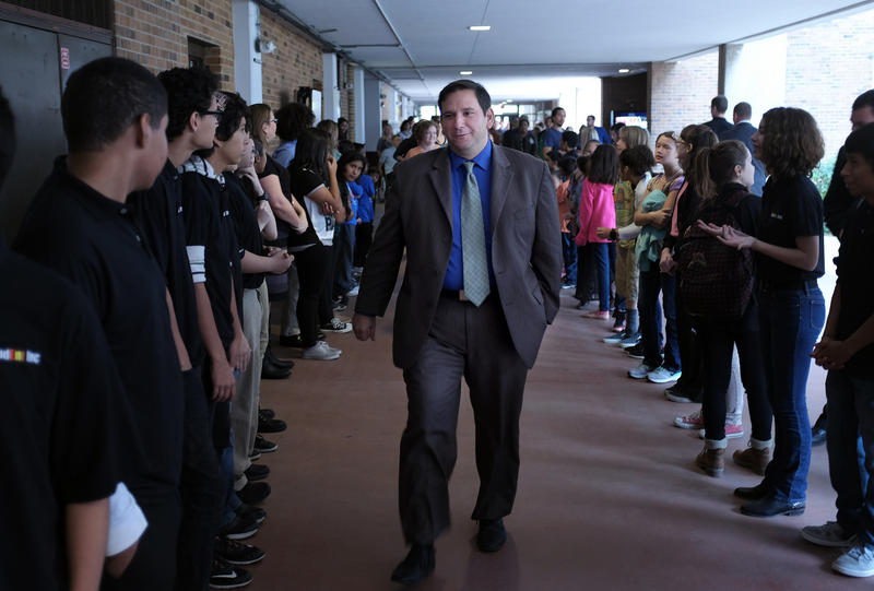Crocket HS Principal Craig Shapiro walks down the school halls among students after the launch of a new entrepreneurship program.