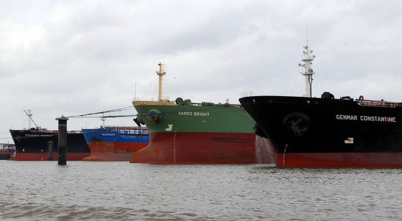 Oil tankers have been backed up in the Houston Ship Channel, a sign of the current global glut of oil reserves.