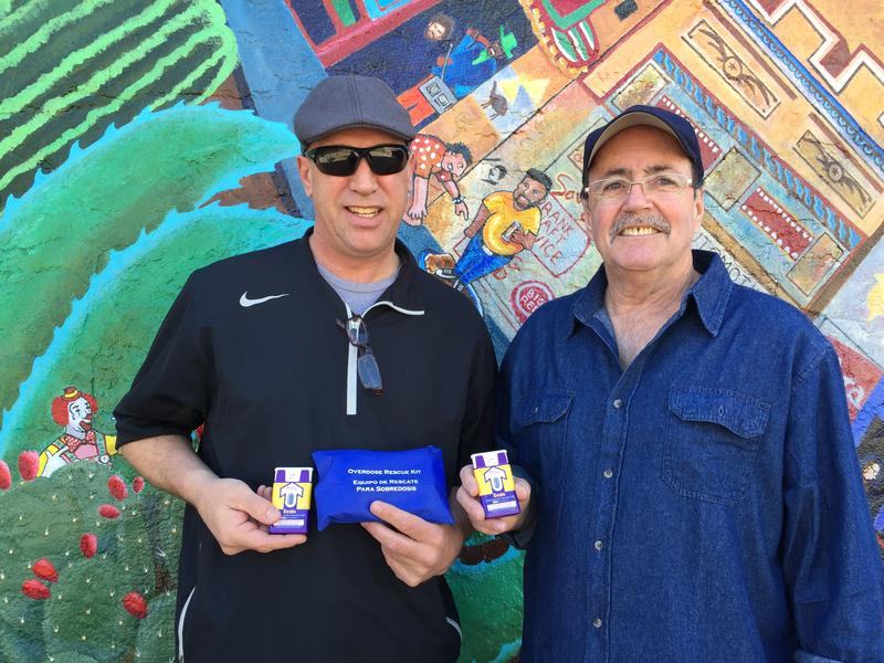 Advocates Mark Kinzly (left) and Charles Ray Thibodeaux help distribute Naxolone to opioid users along the Drag in Austin.