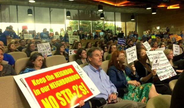 Hundreds packed City Council chambers on Tuesday for the debate on regulations for short-term rentals that aren't owner-occupied.