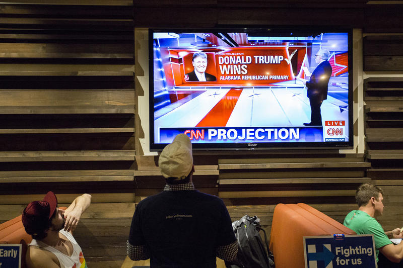 Hillary Clinton supporters gather in downtown Austin to watch Super Tuesday results come in.