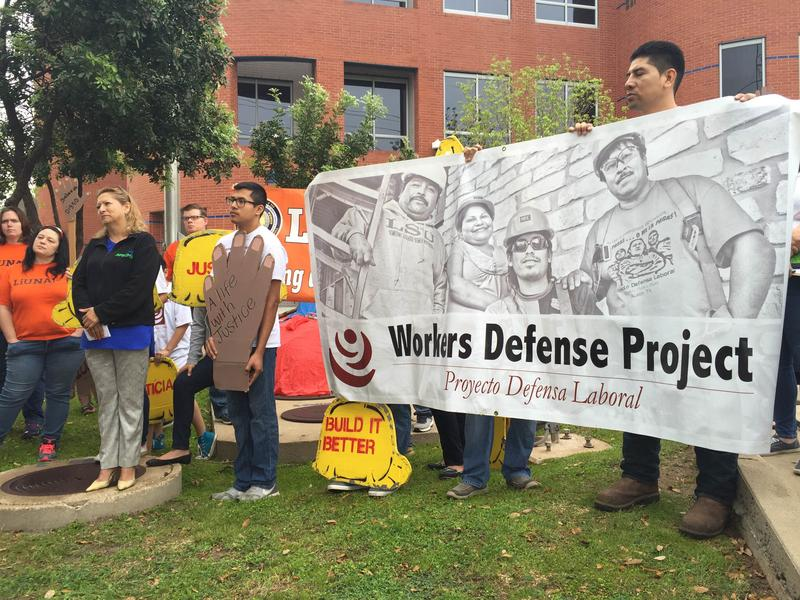 Advocates from the Workers Defense Project gathered outside the Capital Metro headquarters yesterday, calling for living wages, independent safety oversight and expanded safety training for workers on the Saltillo Project.