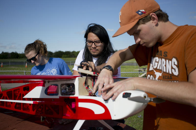 UT students Hallie Ford, Eduardo Velasquez and Jake Farrington work on their drone before a mock rescue mission.