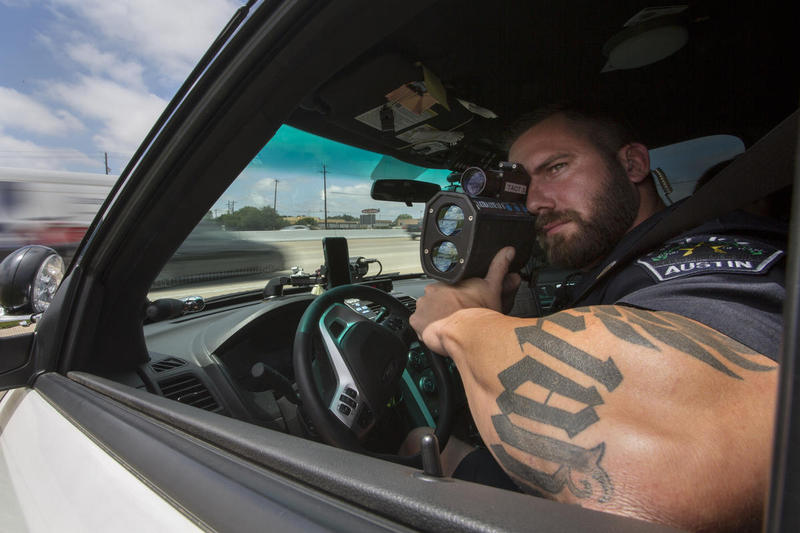 Officer Jason Borne scans Texas State Highway 183 for speeders.