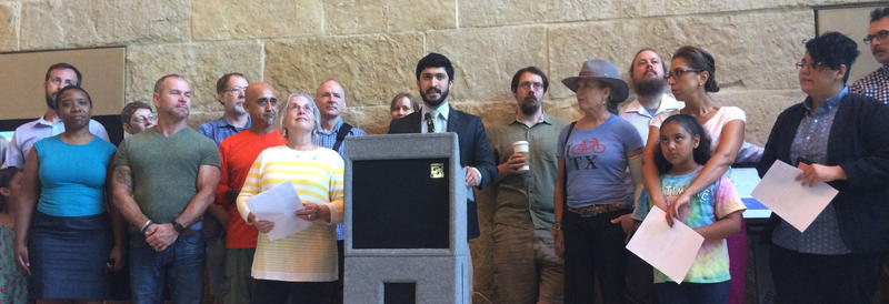 Council Members Casar and Pool at yesterday's announcement of a competing transportation bond.