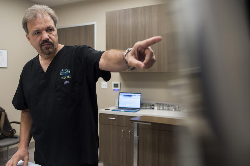 Dr. David Harris in his office at the Center for Healing and Regenerative Medicine. He says, while his clinic uses stem cell treatments, he largely treats physiological conditions, not neurological ones, which are the subject of scrutiny.