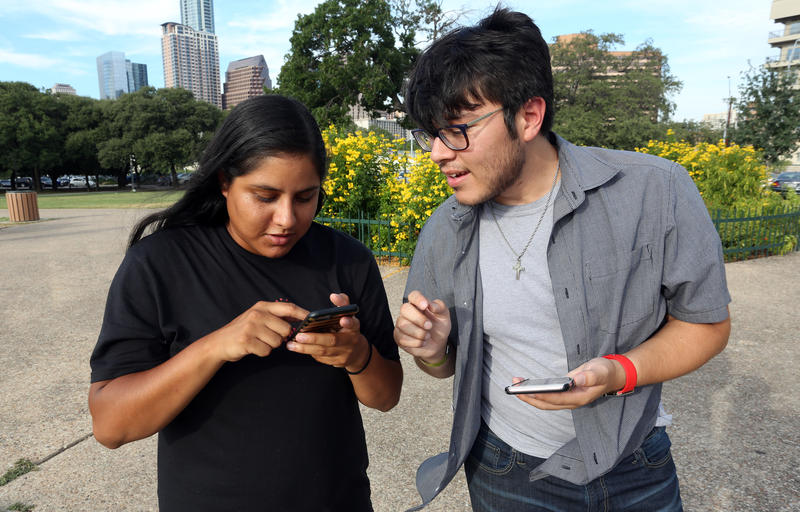 Monica Rodriguez and Jose Sandoval play Pokémon Go at Auditorium Shores on July 19, 2016