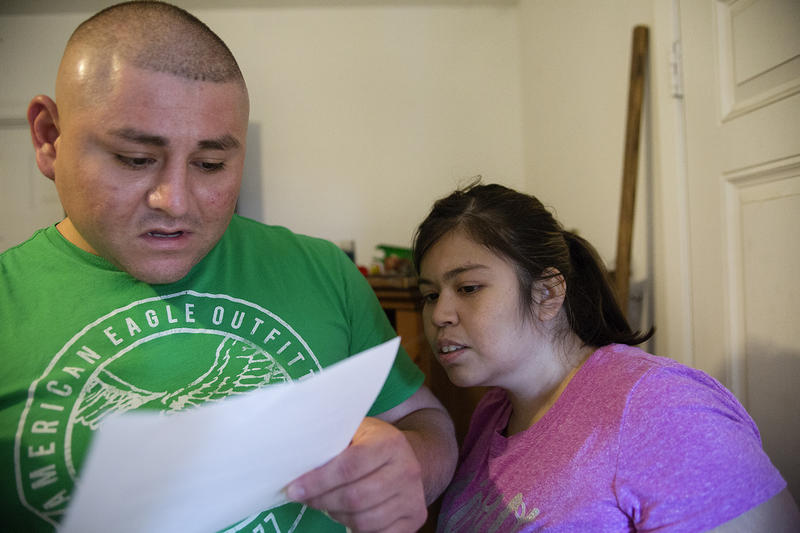 Juan Aranda and Rebekah Jara read a letter regarding their ongoing spat with their landlord, who, they say, unjustly chose not to offer them a lease renewal.