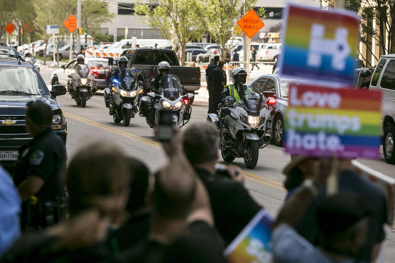 Democratic and anti-Trump demonstrators gather in downtown Austin to protest a visit to the city by Republican presidential candidate Donald Trump.