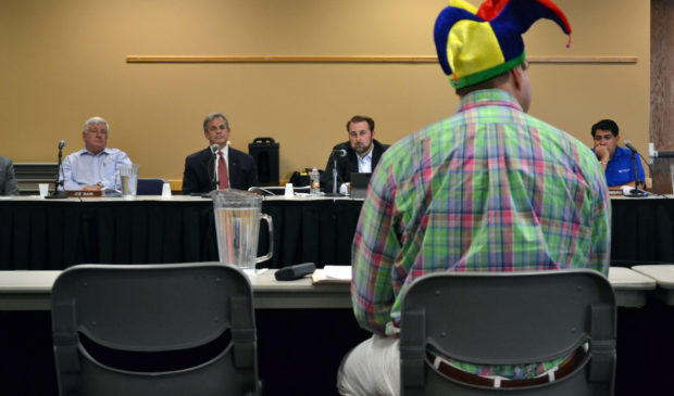 Travis County GOP Chair Rob Morrow, in his signature jester's cap, testifies before CAMPO on August 8, 2016.