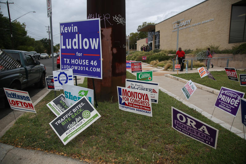 Signs outside of the George Washington Carver Library in Austin ahead on Election Day in 2014.