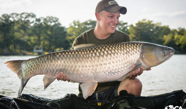 Clayton Lothrop holds a 40-pound grass carp he caught during an Austin Carp Anglers competition.