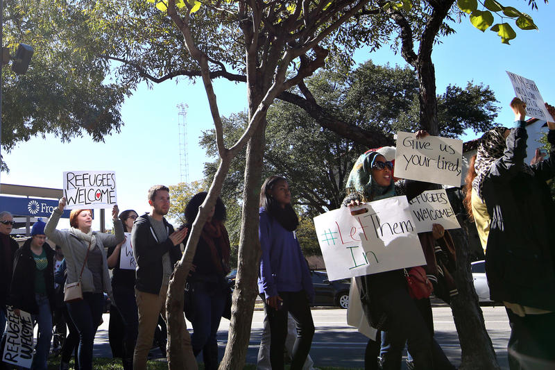 Protesters march to the Governor's Mansion to rally against Gov. Abbott's efforts to discourage the resettlement of Syrian refugees in Texas on November 22, 2015.