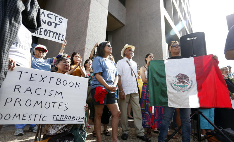 The Responsible Ethnic Studies Textbook Coalition holds a rally to call on the Texas State Board of Education to reject a proposed Mexican-American studies textbook that scholars and experts have said is deeply offensive