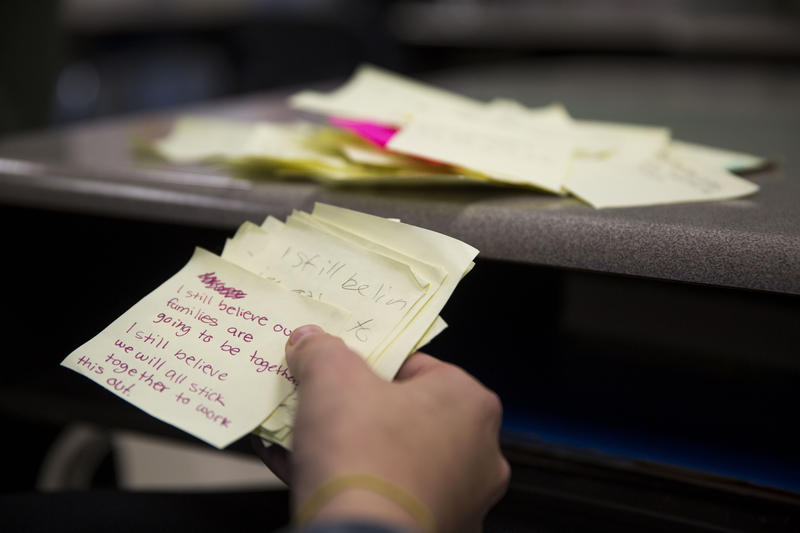 Teacher Jessica Foulke displays notes written by her students following the presidential election. Students were asked to write their hopes for the future.