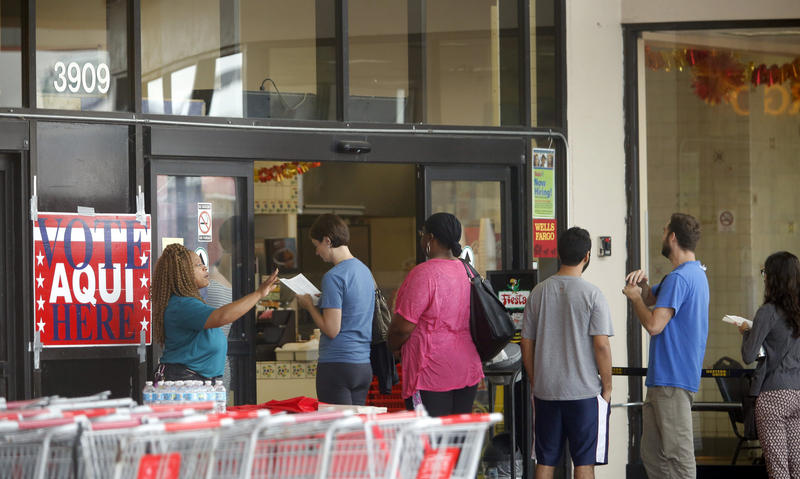 : Voters line up outside of a Fiesta grocery store at 38th St. and interstate I-35.