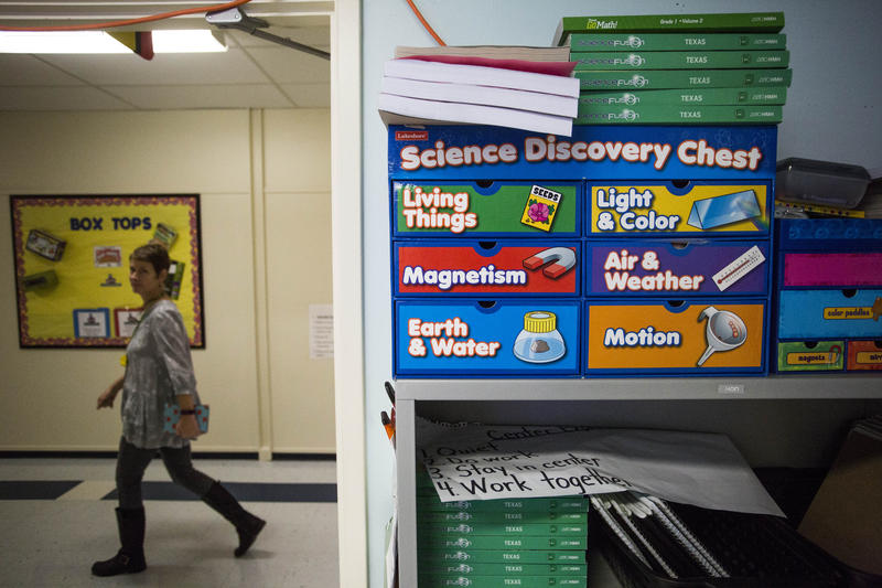 Science textbooks and supplies in a first grade classroom.