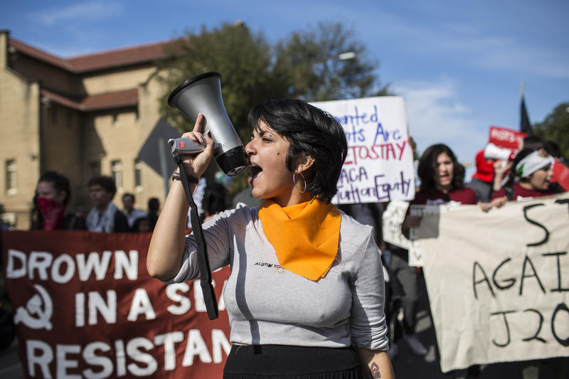 Andrea Flores leads protesters in the march through UT campus.