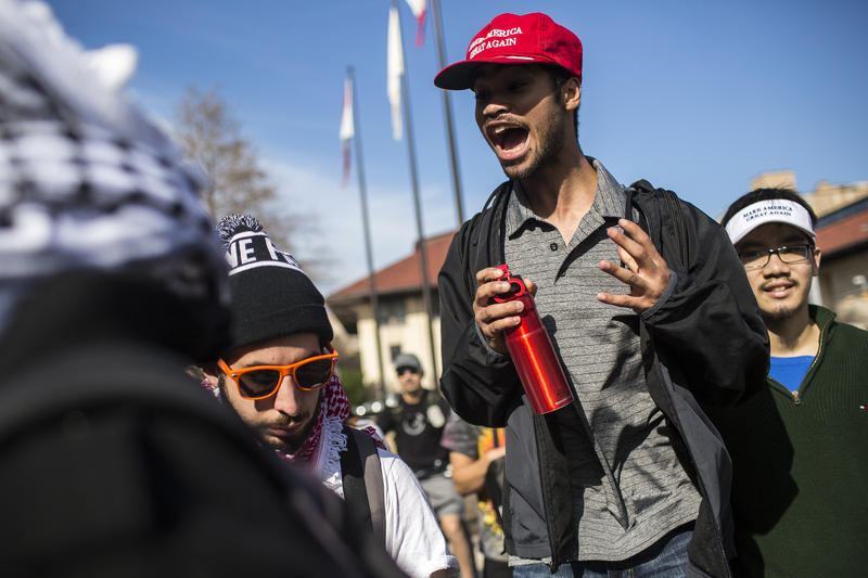 Trump supporters David Green and Brian Le, UT freshmen, argue with protesters.