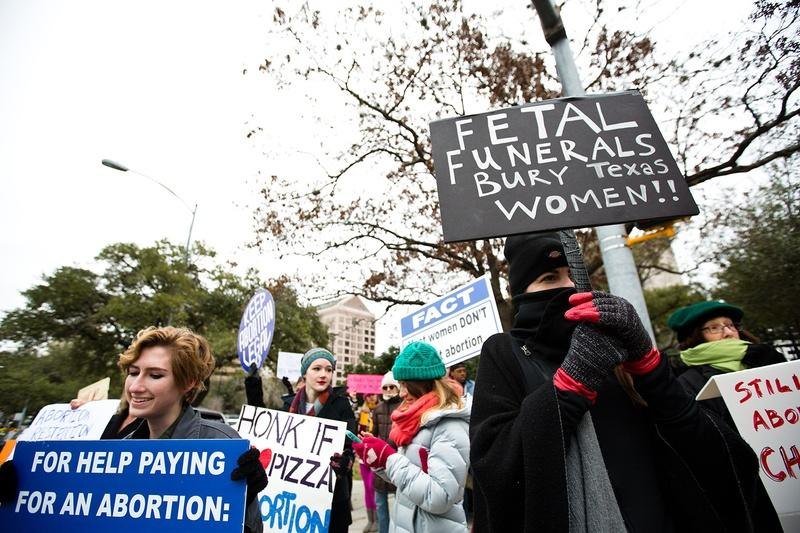 Demonstrators protest Texas' fetal remains burial rule outside the governor's mansion on Jan. 6.