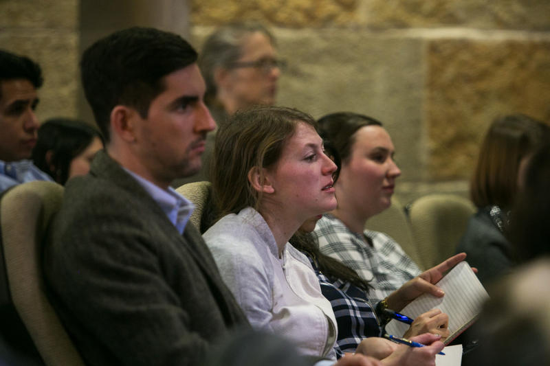 Amy Stansbury (center) with the Austin Young Chamber of Commerce takes notes during the 2017 State of the City led by Mayor Steve Adler at the Austin City Hall.