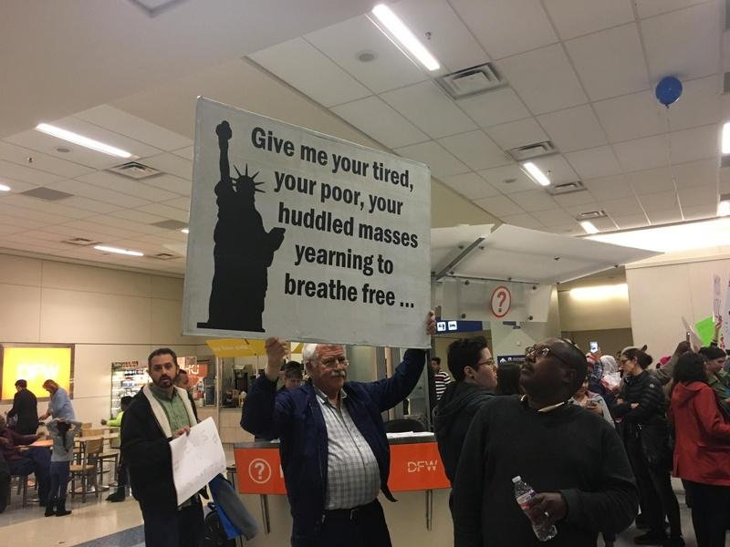 A protester at DFW International Airport on Saturday January 28, 2017.