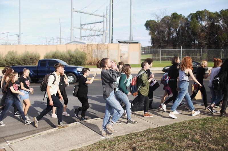 Students from McCallum High School march in protest of Donald Trump's presidency.