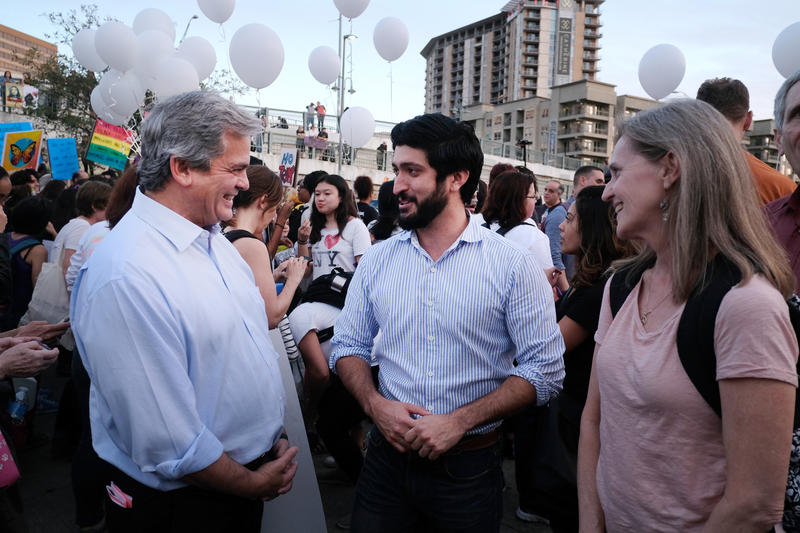 Mayor Steve Adler and City Council member Greg Casar participate in the One Resistance Rally in downtown Austin.