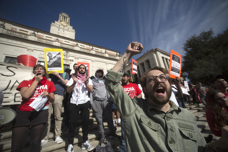 Protesters demonstrate at the steps of the UT Tower.