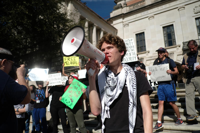 Seth Uzman protests at UT's South Mall on Friday.