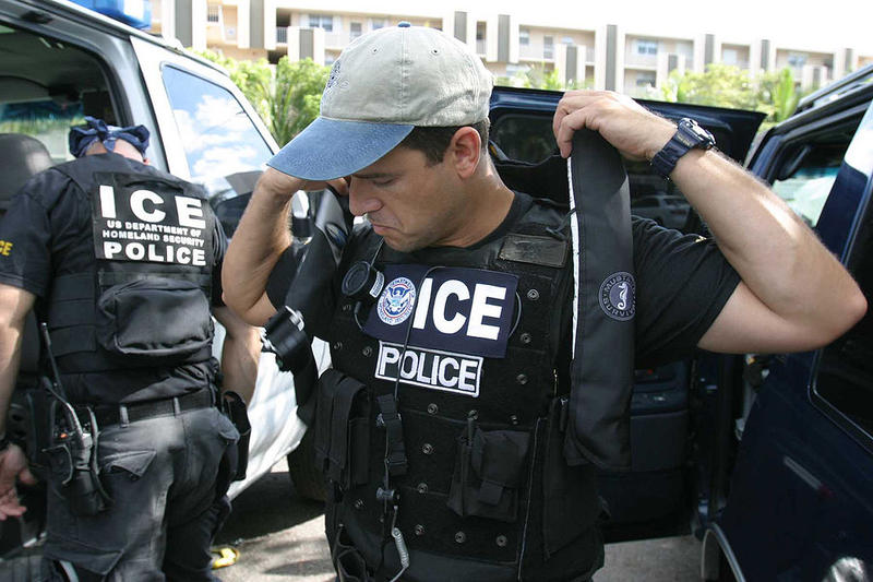 A U.S. Immigration and Customs Enforcement agent suits up.