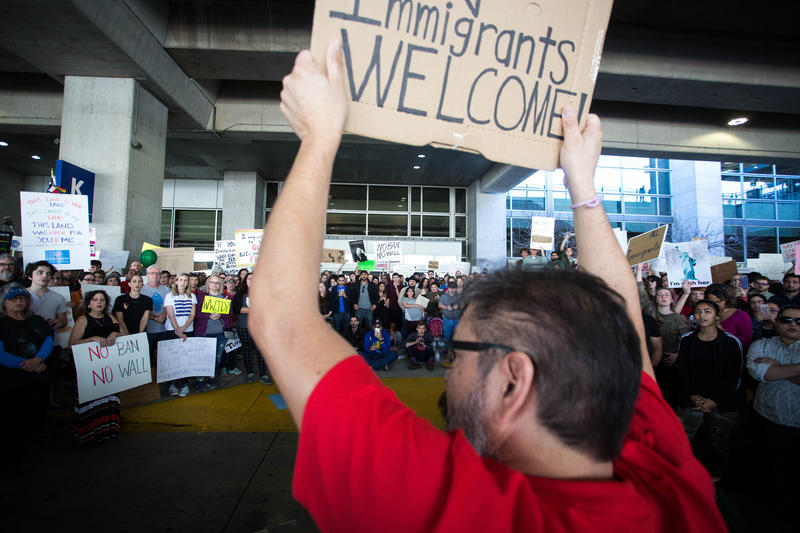 Demonstrators at Austin-Bergstrom International Airport protest President Trump's order banning travelers from seven majority-Muslim countries from entering the U.S. last month.