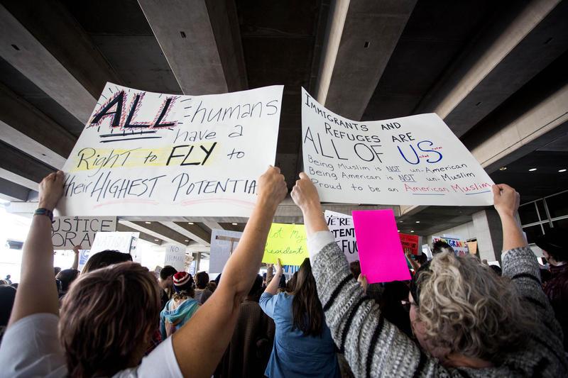 Demonstrators at Austin-Bergstrom International Airport protest President Trump's travel ban last month.