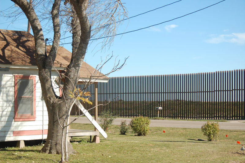Part of the existing border wall sits close to a Brownsville neighborhood.