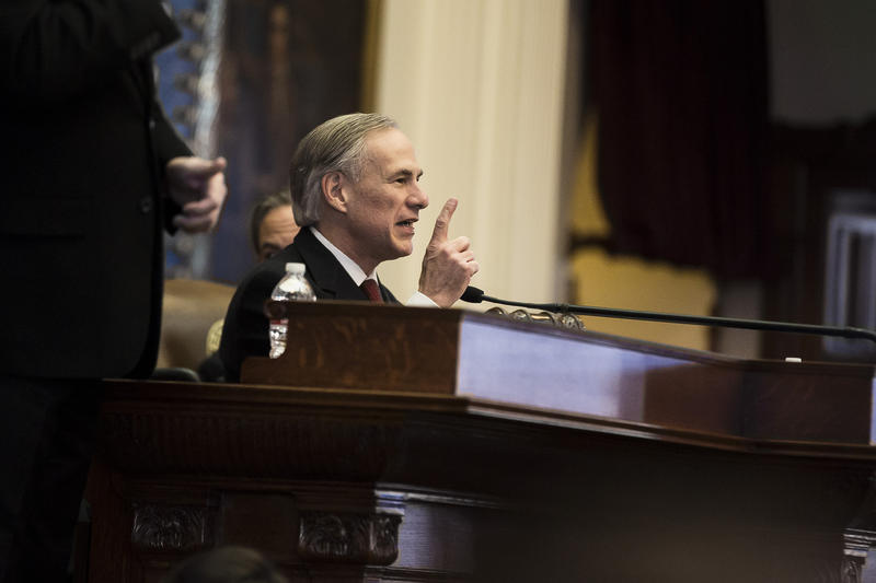 Gov. Greg Abbott delivering his State of the State address in the Texas House on Tuesday.