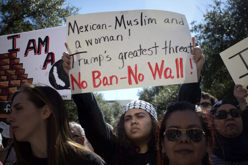 Iman Haje of Austin holds up a sign at the rally.