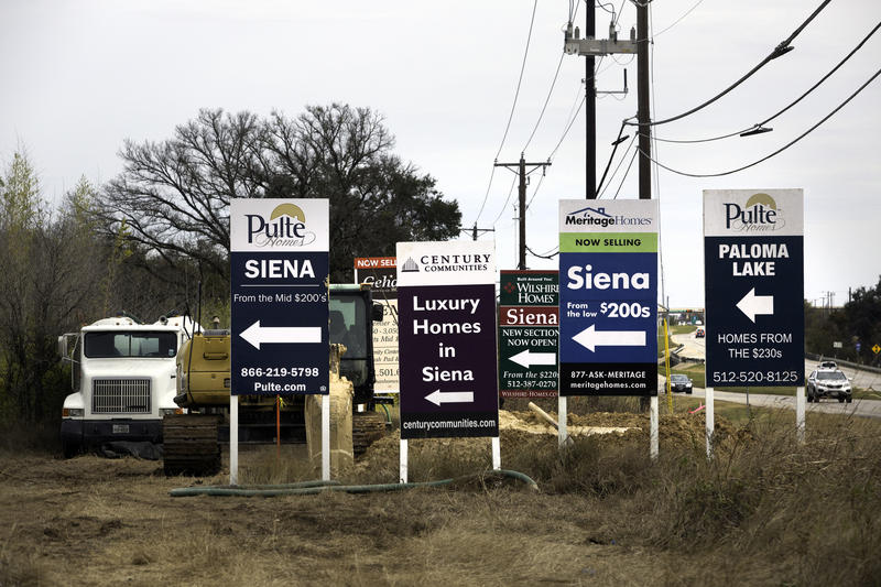 Signs advertising news home developments in the fast-growing Austin suburb of Round Rock.
