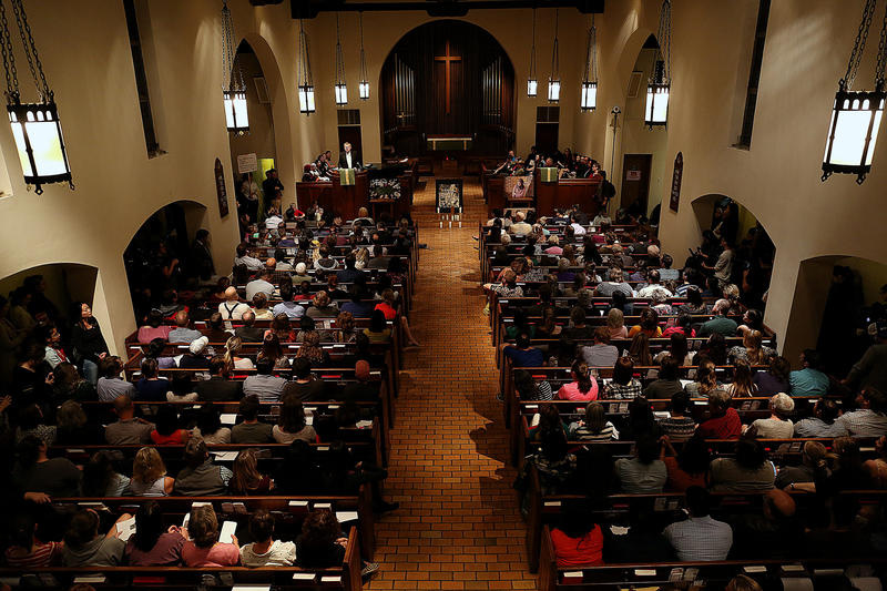 Hundreds attend an interfaith community vigil for refugees at First English Lutheran Church on Jan. 30. Three days earlier, President Trump signed an executive order barring refugees from seven majority-Muslim countries from entering the U.S.