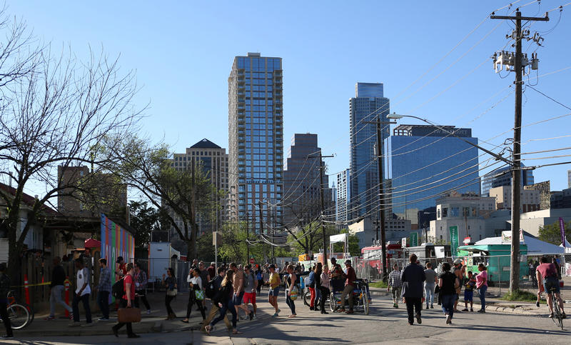 Pedestrians walk down Rainey Street during South by Southwest last week. A developer agreed to commission a traffic study of the area to help improve congestion and pedestrian safety.